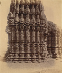 Close view of wall of main shrine and shikara of the Gondeshvara Temple, Sinnar, showing moulding and sculptural detail